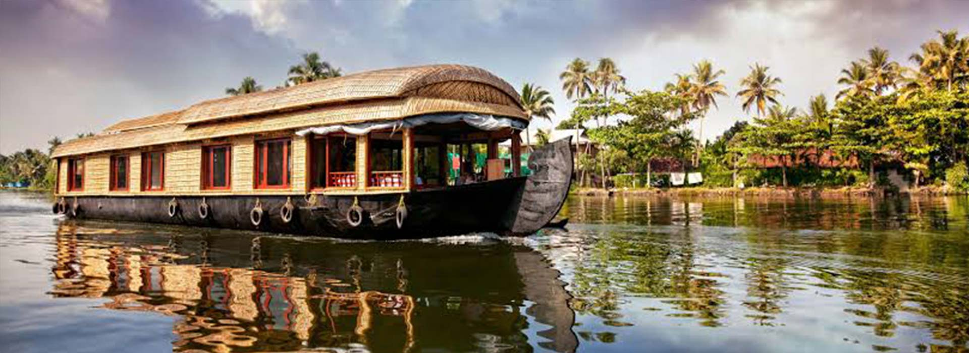 KERALA'S JOURNEY THROUGH BACK WATERS By HOUSEBOAT